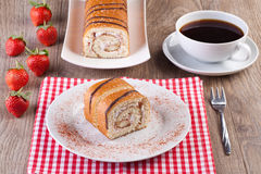 Strawberry swiss roll with a cup of coffee Stock Image