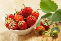 Strawberry on a table. Strawberry in a dish on a table, studio shot Royalty Free Stock Images