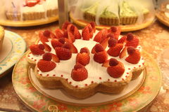 Strawberry tart. A homemade strawberry tart with fresh cream Royalty Free Stock Images