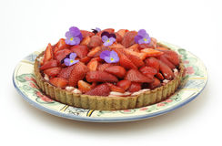 Strawberry tart. On round plate, white background Royalty Free Stock Images