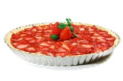 Strawberry tart. With a mint leaf and apple-rhubarb inside, on a white background, on a silver patter Stock Images