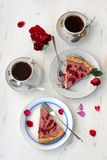 Strawberry tart with black tea and roses. On the white background Royalty Free Stock Images