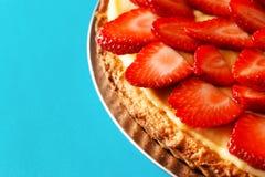 Strawberry tart on blue background Royalty Free Stock Image