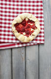 Strawberry tart on checked red and white table cloth Royalty Free Stock Photos