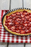 Strawberry tart on checkered red and white table cloth Royalty Free Stock Images