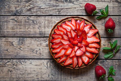 Strawberry tart with cream and mint traditional summer sweet pastry Royalty Free Stock Image