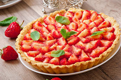 Strawberry tart with custard Stock Images