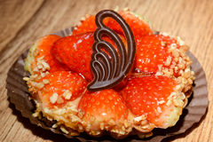 Strawberry tart with milk chocolate decoration Stock Images