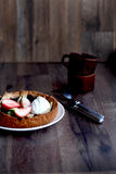 Strawberry tart on a plate. Wooden board, knife and fork Stock Images