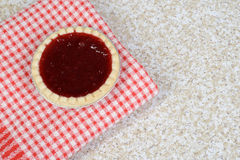 Strawberry tart on red checkered napkin Royalty Free Stock Photography