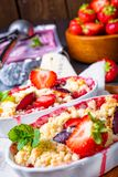 Strawberry tart with vanilla pudding and ice cream. A strawberry tart with vanilla pudding and ice cream royalty free stock images