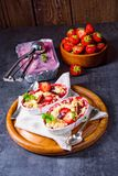 Strawberry tart with vanilla pudding and ice cream. A strawberry tart with vanilla pudding and ice cream stock image