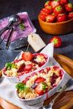 Strawberry tart with vanilla pudding and ice cream. A strawberry tart with vanilla pudding and ice cream Stock Photography
