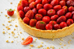 Strawberry tart on white wooden background Stock Photography