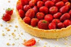 Strawberry tart on white wooden background Royalty Free Stock Photos