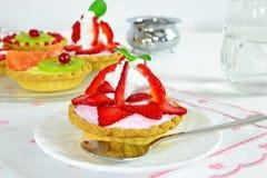 Strawberry tartlet closeup royalty free stock photography