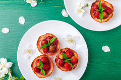 Free Strawberry Tartlet On White Plates On Green Background. Top View. Royalty Free Stock Image - 97887626