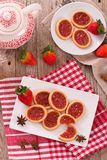 Strawberry tartlets. Strawberry tartlets with tea on white dish Royalty Free Stock Photos
