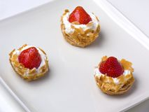 Strawberry tarts on a sqare plate Royalty Free Stock Photos