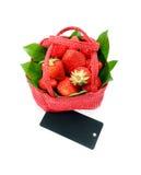 Strawberry. Tasty strawberry on white background. Strawberry in a red basket on a white background Stock Photos
