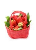 Strawberry. Tasty strawberry on white background. Strawberry in a red basket on a white background Stock Image