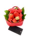 Strawberry. Tasty strawberry on white background. Strawberry in a red basket on a white background Stock Images