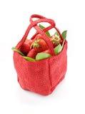 Strawberry. Tasty strawberry on white backgroundnStrawberry in a red basket on a white background Royalty Free Stock Photo