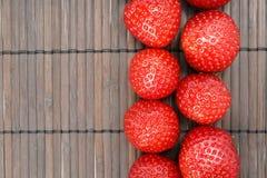 Strawberry. Tasty strawberry on wooden background Royalty Free Stock Photo
