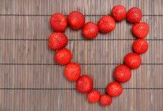 Strawberry. Tasty strawberry on wooden background Stock Photos