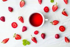 Strawberry tea and fruit flatlay Royalty Free Stock Images
