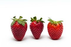 Strawberry. Three strawberries on white background stock photos
