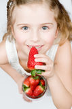 Strawberry time. Girl eating strawberries Royalty Free Stock Photography