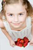 Strawberry time. Girl with fresh strawberries Royalty Free Stock Image