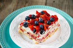 Strawberry tiramisu with mascarpone and blueberry stock images