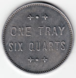 Strawberry Token 6 Quarts. Antique strawberry token.  One tray, six quarters.  Pewter tone with embossed edge Stock Image