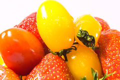 Strawberry with tomatoes Royalty Free Stock Photos