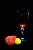 Strawberry tomatoes and glass of red wine Royalty Free Stock Images