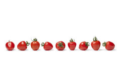 Strawberry tomatoes in a row Stock Photo