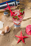 Strawberry tropical cocktail with shaker and starfish Royalty Free Stock Photography