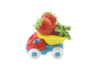 Strawberry in the truck. Ripe strawberries in the back of the toy truck Stock Photo