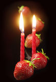 Strawberry and two candles Royalty Free Stock Photos