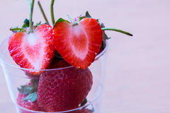 Strawberry. Two cutted strawberry on glass Royalty Free Stock Images