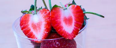 Strawberry. Two cutted strawberry on glass Royalty Free Stock Photography