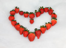 Strawberry Valentine Heart. Strawberries in the snow in a Heart Shape Stock Photography