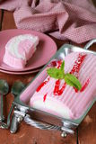 Strawberry vanilla cake roll ice cream with mint Stock Images