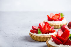 Strawberry vanilla cream cheese tarts over light gray table Stock Photography
