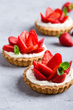 Strawberry vanilla cream cheese tarts over light gray table Royalty Free Stock Photo