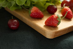 Strawberry and vegetables Stock Photography