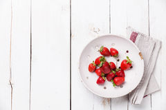 Strawberry in Vintage ceramic colander on white wo Stock Photos