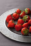 Strawberry on vintage plate Stock Images